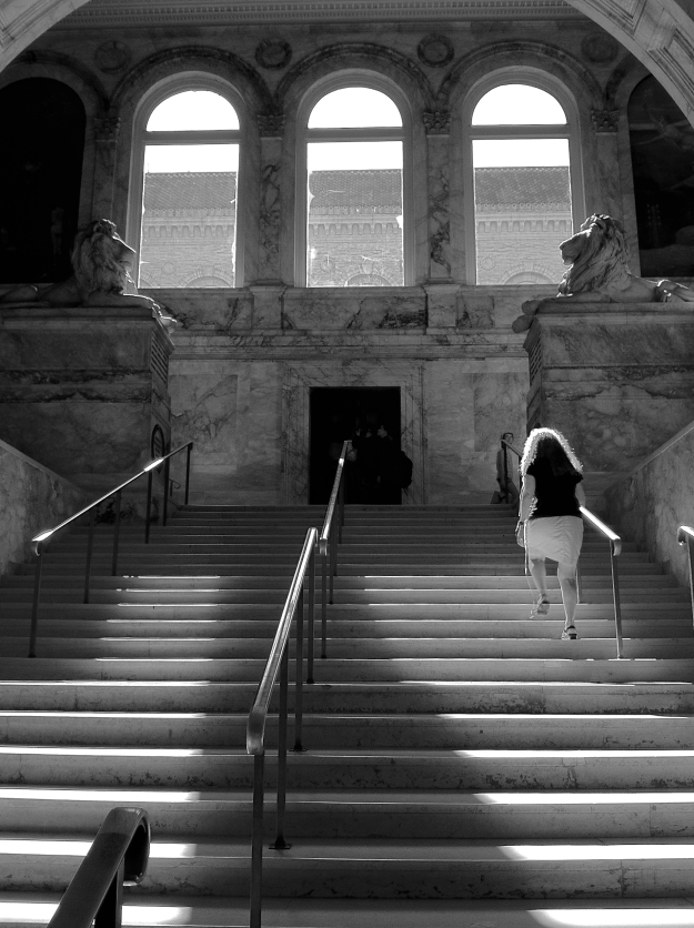 Walking up the main staircase at the Boston Public Library