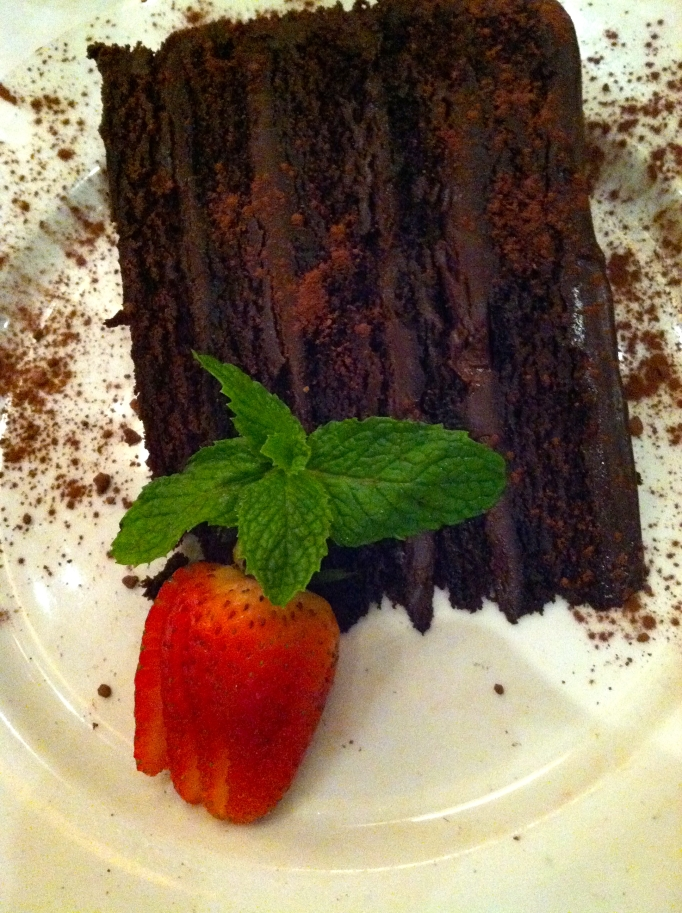 Enjoying a slice of chocolate cake at Papa Razzi, Newbury Street