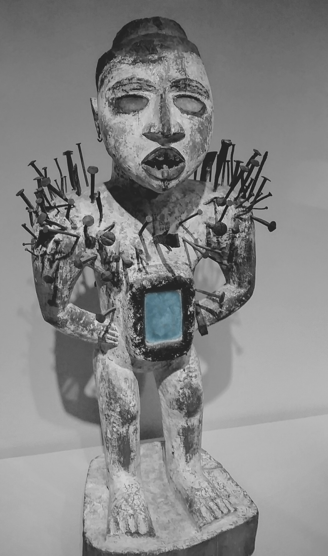 African Power Figure with Blue Accent.